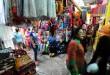 Seorang pedagang menunggu pembeli yang berada di Pajak Ikan Lama, Medan, Senin (29/6). Jelang lebaran Pajak Ikan Lama menjadi salah satu tempat warga dari Aceh dan Medan untuk membeli kain dan mukena. (WOL Photo/Ega Ibra)