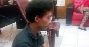 Tersangka Putra Rezeki alias Putra (23) kasus penggelapan mobil rental. (WOL Photo/Gacok)