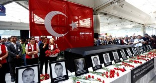 Airport employees attend a ceremony for their friends, who were killed in Tuesday's attack at the airport, at the international departure terminal of Ataturk airport in Istanbul, Turkey, June 30, 2016. REUTERS/Murad Sezer