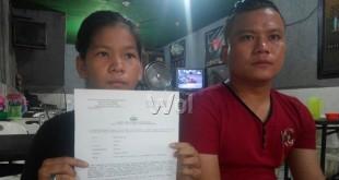 Pelajar SMP, Erika Beru Sinulingga sambil memegang kertas tanda bukti sudah membuat pengaduan, penganiayaan dilakukan belasan preman. (WOL. Photo/gacok)