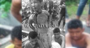 Tiga tersangka pencuri tabung gas babak belur dihajar massa dan diikat di batang pohon.(WOL. Phpto/gacok)