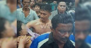Warga dibantu Polsek Medan Barat temukan jenazah Melly, hanyut Sungai Deli, Kecamatan Medan Labuhan.(WOL Photo/Gacok)