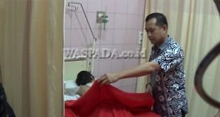 Kepala Rumkit RS Bhayangkara Medan, Kombes Farid Armansyah, saat memperlihatkan kondisi korban KDRT, Sabtu (17/9).