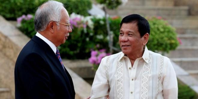 Perdana Menteri Malaysia Najib Razak bersama Presiden Filipina Rodrigo Duterte (Foto: Edgar Su/Reuters)