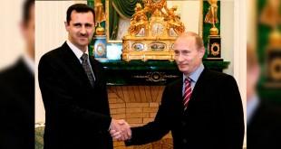 Assad berterima kasih pada Putin. (Foto: TASS/AP)