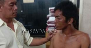 Penyidik Pembantu Reskrim Polsek Medan Sunggal, sedang interogasi tersangka curanmor yang ditangkap korbanya.(WOL. Photo/gacok)