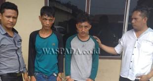 Dua Penyidik Pembantu Reskrim Polsek Medan Sunggal usai introgasi tersangka perampokan.(WOL. Photo/gacok)