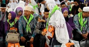 Jamaah haji koter 1 Embarkasi Medan saat tiba di Asrama Haji, Medan, Kamis (7/9). Sebanyak 391 jamaah haji tiba usai menjalankan ibadah haji di Tanah Suci. (WOL Photo/Ega Ibra)