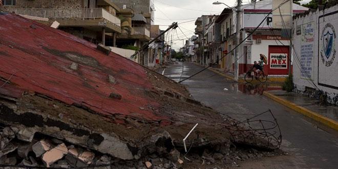 Bangunan runtuh akibat gempa 8.1 skala richter di Juchitan, negara bagian Oaxaca, Meksiko, Ahad (10/9) (AP Photo)