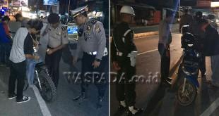 Polsek Medan Sunggal dibantu 2 personel BKO Polisi Meliter (PM) sedang menggelar razia dan hunting, Minggu dini hari (29/10). (WOL Photo/Gacok)