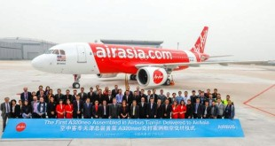 (13th from right) Airbus President of China Mr Eric Chen, AirAsia Berhad Chief Executive Officer Ms Aireen Omar, Airbus Final Assembly Line Asia (FALA) team in Tianjin and invited guests with the new AirAsia A320neo.