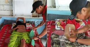 Tim dokter tengah melakukan sunatan terhadap seorang anak dalam rangka bakti sosial Prakas Naungan RAPI di Mushola Al Ikhlas di Desa Sikeben, Sibolangit., Minggu (22/10). (WOL Photo/Gacok)