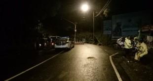Polisi siaga di kawasan Puncak. Foto Okezone/Putra Ramadhani